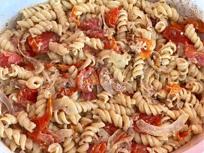 cheesy tomato pasta in a casserole dish