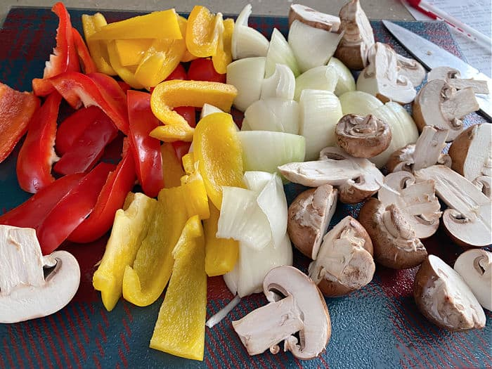 cut up onions peppers and mushrooms