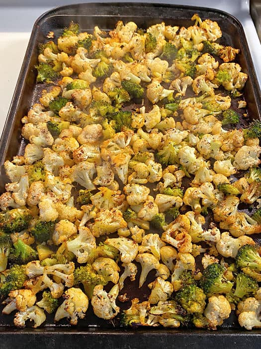sheet pan of roasted broccoli and cauliflower