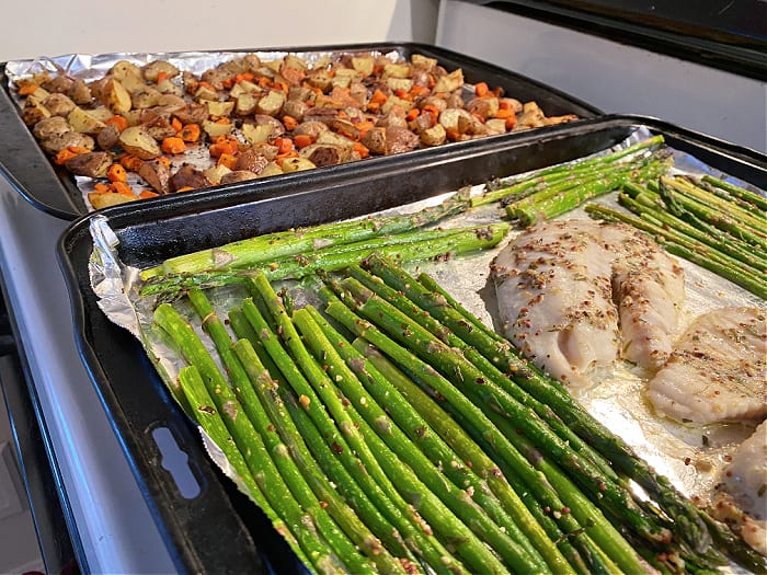 finished fish and veggies on baking sheets