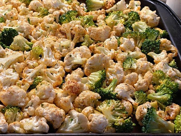 seasoned cauliflower and broccoli on a sheet pan