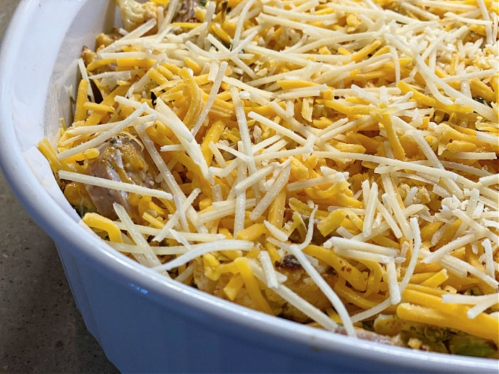 top the casserole with shredded cheese