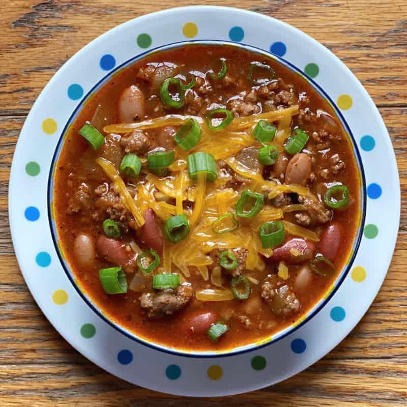 Bowl of sausage and ground beef chili with salsa verde