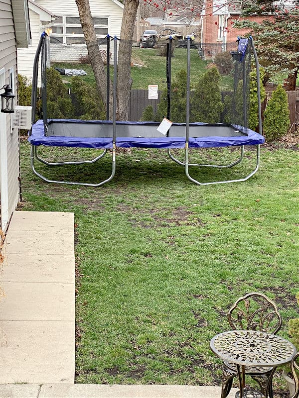 trampoline with a basketball hoop