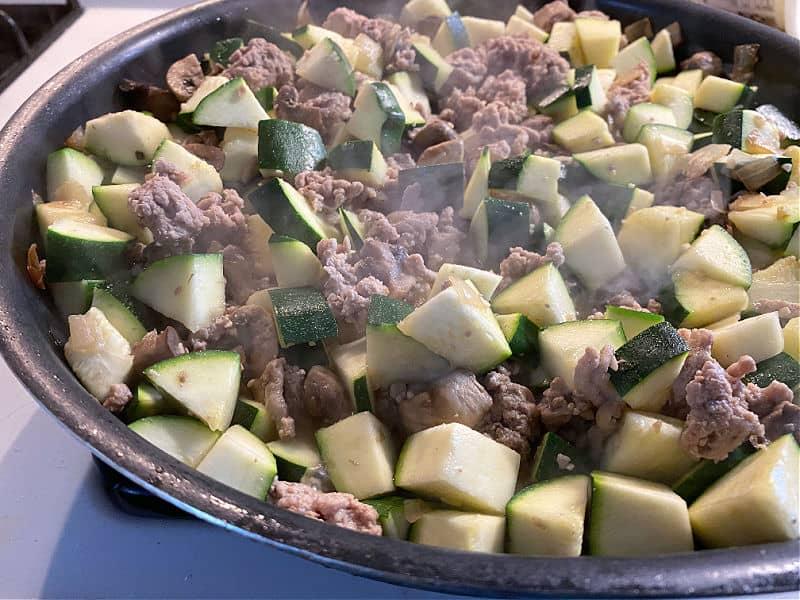 add zucchini to the skillet