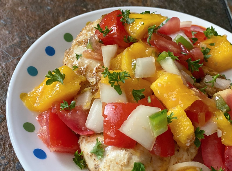 chicken topped with fresh salsa