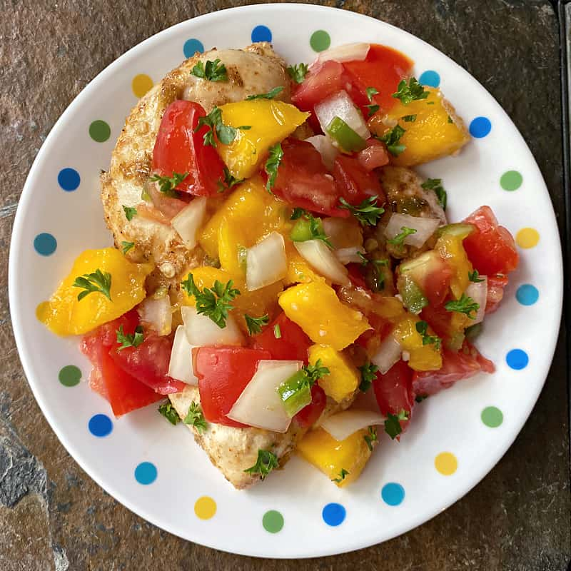 chicken topped with fresh chunky mango-tomato salsa