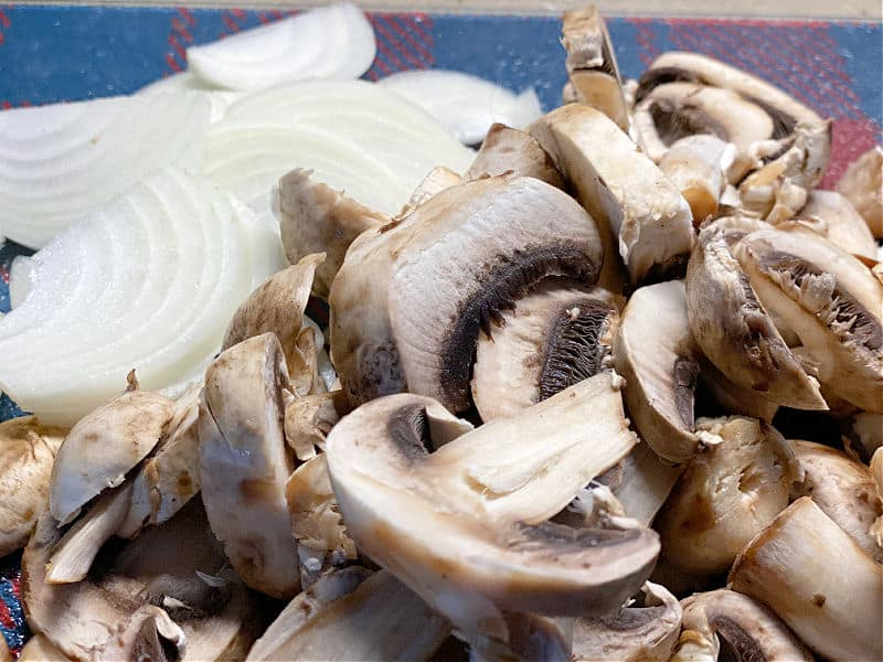 cut up mushrooms and onions for stir fry