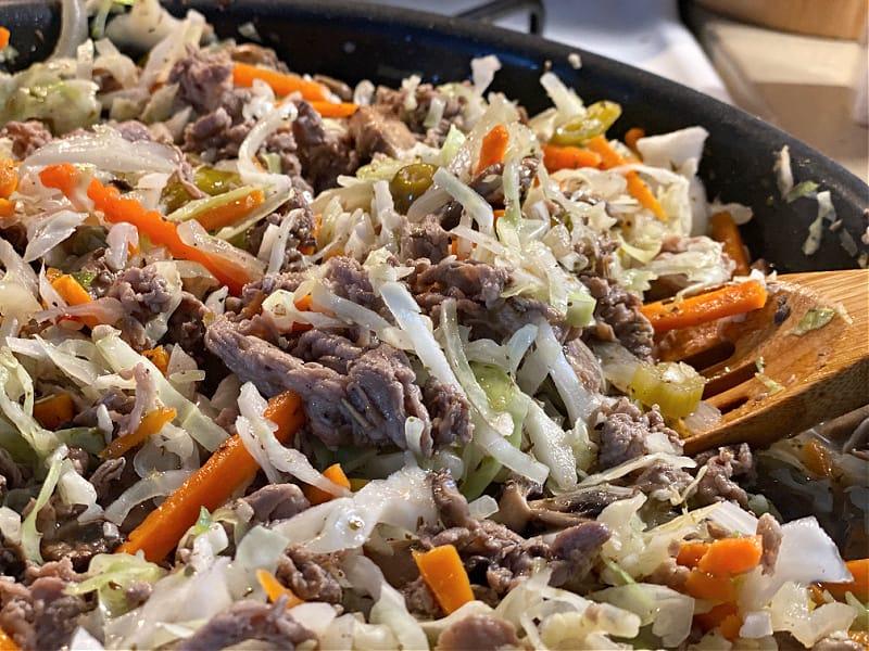 pan of cabbage beef and giardiniera stir fry