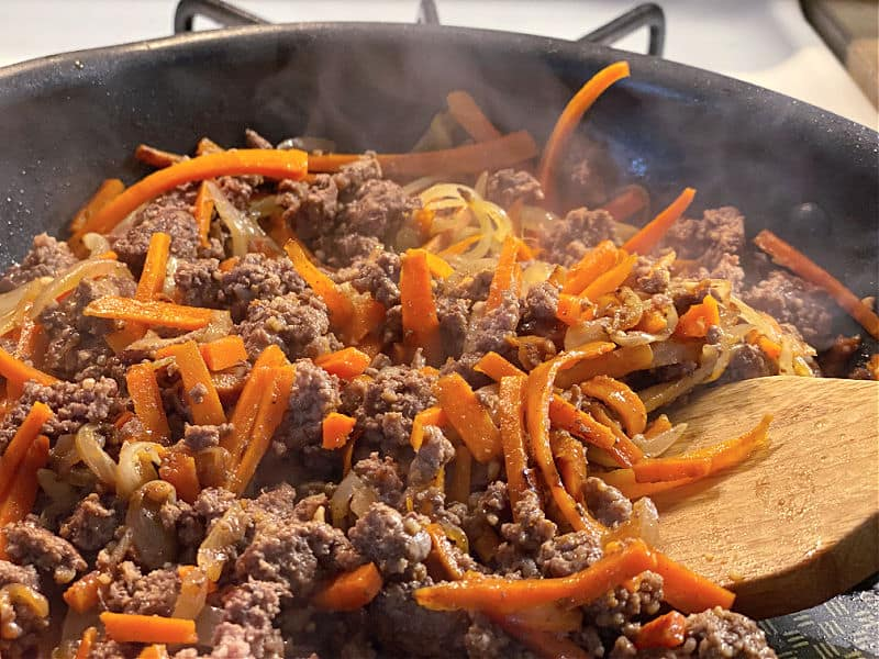 Brown the ground beef with carrots and onion