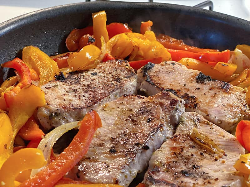 pork chops and peppers in pan