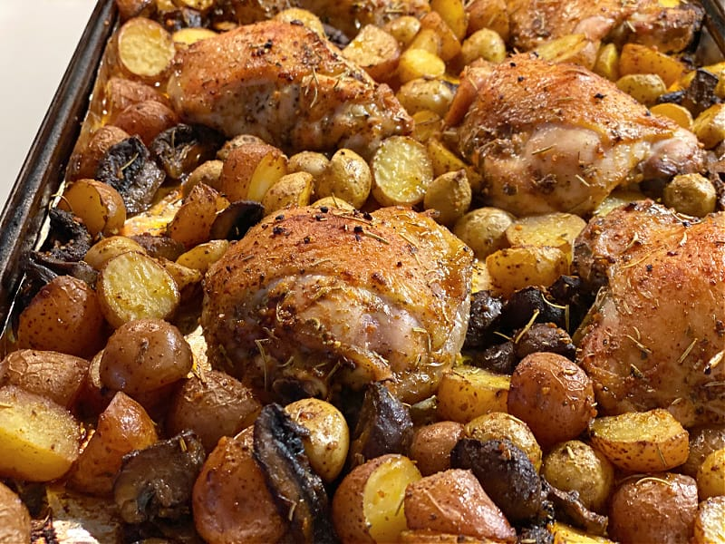 browned chicken and potatoes on pan